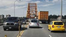 The Pattullo Bridge links the B.C. communities of Surrey and New Westminster. The latter is calling for a four-lane toll bridge to replace the 77-year-old structure. (Jeff Vinnick For The Globe and Mail)