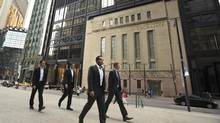 People walks past the Toronto Stock Exchange building in July, 2013. (Gloria Nieto/The Globe and Mail)