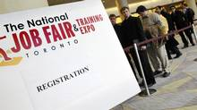 Dozens of people line up to register for the The National Job Fair & Training Expo at the Metro Toronto Convention Centre, 2012. (J.P. MOCZULSKI For The Globe and Mail)