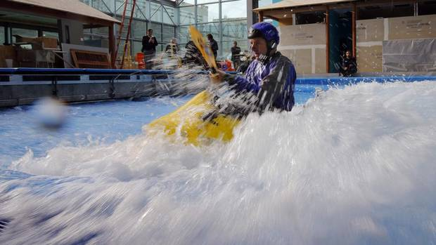 Jeff Fluet from NH Kayak Center tests the waves in a kayak in the still under-construction Surf's Up indoor water and surf park in Nashua, New Hampshire (BRIAN SNYDER/REUTERS)