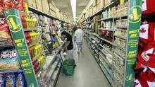 Shoppers load up on bargains at the Dollarama store on Spadina Avenue in Toronto. (Deborah Baic/The Globe and Mail)
