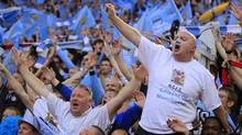 Manchester City fans celebrate their win over Stoke City at the end of their English FA Cup Final soccer match at Wembley Stadium, London, Saturday, May 14, 2011. (Associated Press)
