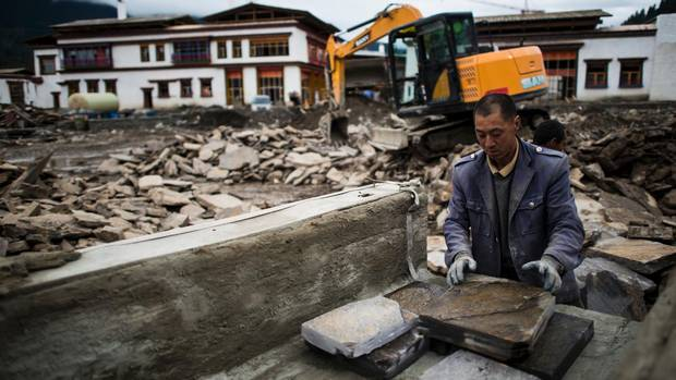 A man working at a construction site next to the Artel hotel in Lulang, near Nyingchi in China's Tibet Autonomous Region.