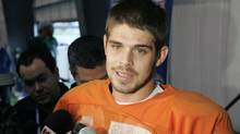 Hawaii quarterback Colt Brennan (15) answers questions after practice in Metairie, La. Sunday, Dec. 30, 2007. (Bill Haber/Associated Press)