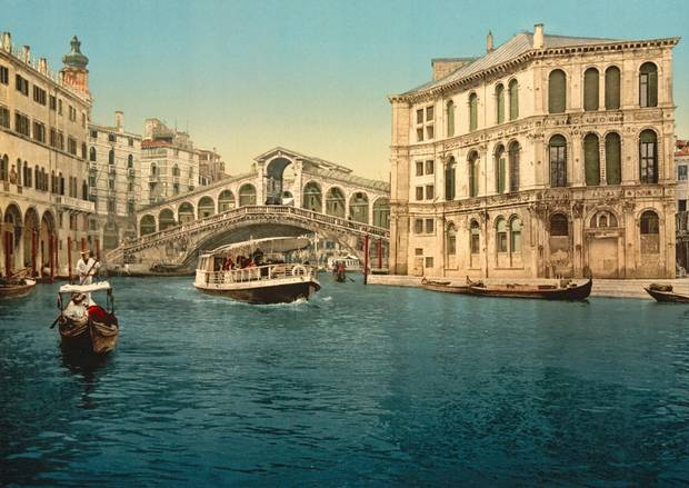 The Rialto Bridge seen over the Venice's Grand Canal in the late-19th century.