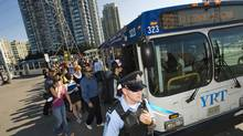 Pasengers board a YRT bus Sept. 25, 2008. (Aaron Vincent Elkaim for The Globe and Mail/Aaron Vincent Elkaim for The Globe and Mail)