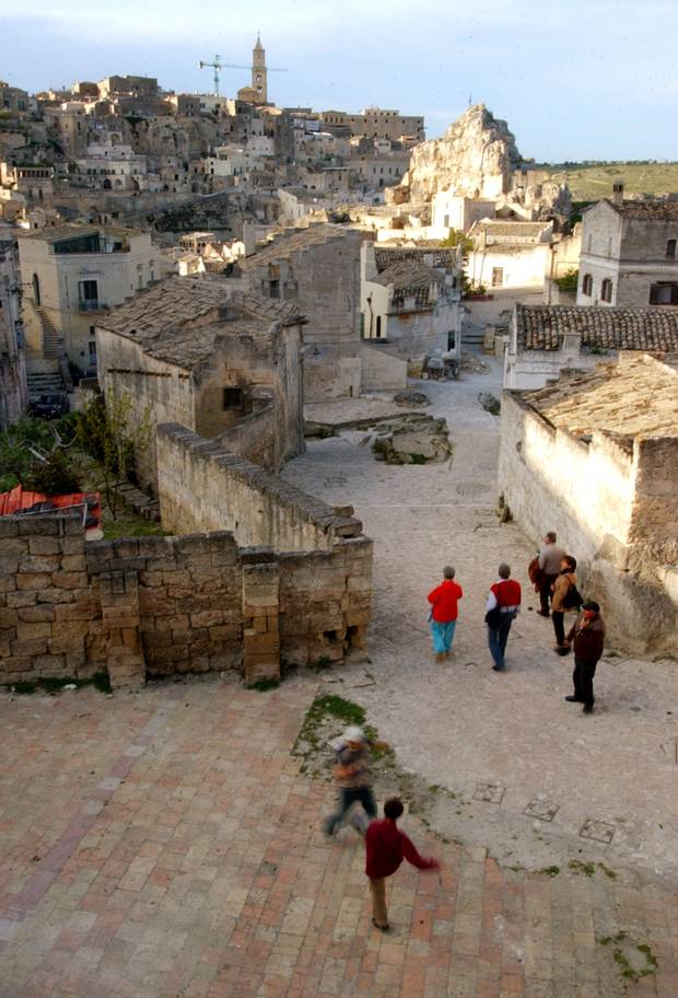 Children play in the sassi area of Matera, a UNESCO World Heritage site.