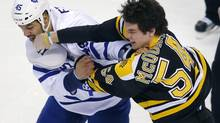 Toronto Maple Leafs defenceman Mark Fraser (L) and Boston Bruins defenseman Adam McQuaid fight in the first period of their NHL hockey game in Boston, Massachusetts March 7, 2013. (BRIAN SNYDER/REUTERS)