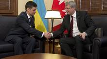 Prime Minister Stephen Harper meets with Vadym Prystaiko, the Ukrainian ambassador to Canada, Monday March 17, 2014 in Ottawa. (Adrian Wyld/THE CANADIAN PRESS)