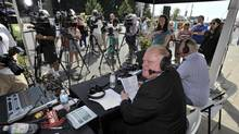 Toronto Mayor Rob Ford, right, and brother Doug air their Sunday radio show on location at the Canadian National Exhibition grounds on Aug. 18, 2013. (J.P. MOCZULSKI FOR THE GLOBE AND MAIL)