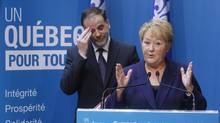 Quebec Premier Pauline Marois and Pierre Duchesne, Minister of Higher Education, speak at the province's education summit. (CHRISTINNE MUSCHI/REUTERS)