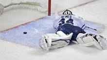 Toronto Maple Leafs goalie James Reimer lays on the ice after getting beat on the game winning goal (Charles Krupa/AP)