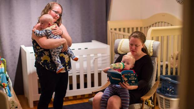 Lindsay Sutton, right, and her wife Laurie with their sons, two-year-old Gavin and five-month-old Elliot, in their apartment in Vancouver.