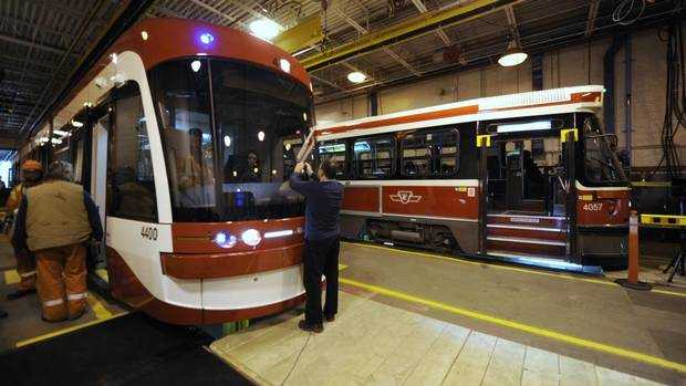 The TTC's new articulated 142 passenger low floor streetcar (LEFT) made by Bombardier. The cars will begin service in 2014. (Fred Lum/The Globe and Mail)
