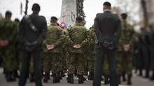 Soldiers stand at attention during Remembrance Day ceremonies at the Vancouver Cenotaph on Nov. 11, 2012. (JOHN LEHMANN/THE GLOBE AND MAIL)