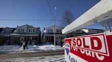 Real estate signs in Toronto's East end on Dec. 16, 2013. (Deborah Baic/The Globe and Mail)