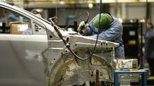 A worker on an assembly line at Ford's Oakville, Ont., plant. (Fred Lum/The Globe and Mail)