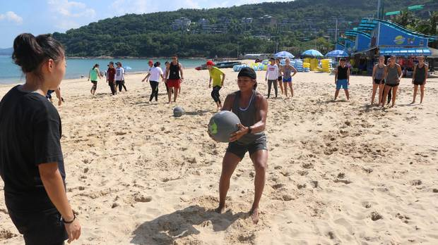 Players train on the beach in Shenzen, southeastern China.