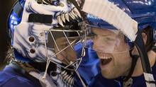 Toronto Maple Leafs goaltender Vesa Toskala, (left) of Finland, and centre Phil Kessel celebrate their win over the Washington Capitals in NHL hockey action in Toronto on Saturday December 12, 2009.THE CANADIAN PRESS/Frank Gunn (Frank Gunn)