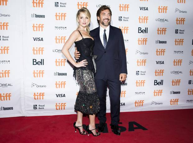 Actors Jennifer Lawrence, left, and Javier Bardem pose on the red carpet for Mother! during TIFF on Sept. 10, 2017.