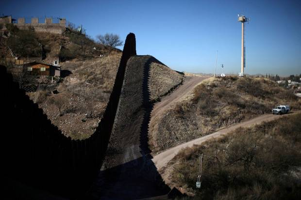 Jan. 31, 2017: A U.S. border patrol agent patrols the border with Mexico in Nogales, Arizona. Illegal crossings in Arizona's Sonoran Desert rose dramatically after crackdowns and fence-building in California and Texas. Scores of migrants died of exposure or drowning.