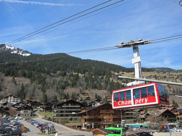 From the village of Champéry, the tram lifts off to snowy slopes.