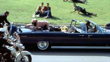 This image provided by Warner Bros. from Oliver Stone's 1991 movie JFK shows a recreation of the assassination of U.S. President John F. Kennedy in Dallas. (AP)