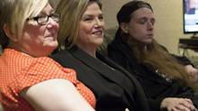 Ontario NDP Leader Andrea Horwath, centre, <137>watches television election coverage<137> on election night with her son Julian Leonetti, right, and sister Susanne Borges.<137>in Stoney Creek, Ont.<137> (Aaron Lynett/THE CANADIAN PRESS)