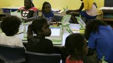 "Australian aboriginal school children work on laptop computers as part of the ""One Laptop Per Child"" program. (STAFF/REUTERS)"