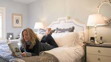 Author Joanna Goodman reads in her bedroom at her home in Toronto. (Kevin Van Paassen/The Globe and Mail)