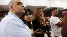 Adel Fahmy, left, brother of Mohamed Fahmy; Wafa Bassiouni, second left, mother of Mohamed Fahmy; and his fiancée, third left, watch proceeding during a sentencing hearing in Cairo on June 23, 2014. (HEBA ELKHOLY/ASSOCIATED PRESS)