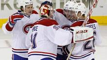 Montreal Canadiens defenceman Raphael Diaz (2nd R) is congratulated by goalie Carey Price (2nd L), center Ryan White (L) and defenceman Josh Gorges (R) after scoring an empty net goal against the New York Rangers in third period action during their NHL game at Madison Square Garden in New York, February 19, 2013. (ADAM HUNGER/REUTERS)