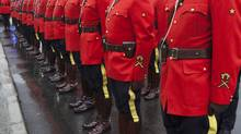 Richmond RCMP parade in front of the newly unveiled $36-million Richmond Community Safety Building, which houses the headquarters of the Richmond RCMP, Nov. 7, 2011. (Brett Beadle for The Globe and Mail/Brett Beadle for The Globe and Mail)