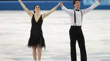 Tessa Virtue and Scott Moir of Canada compete in the team ice dance short dance figure skating competition at the Iceberg Skating Palace during the 2014 Winter Olympics, Saturday, Feb. 8, 2014, in Sochi, Russia. (Ivan Sekretarev/AP)