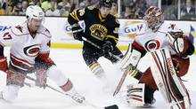 Carolina Hurricanes' Marc-Andre Bergeron clears the puck beside goalie Dan Ellis (AP)