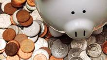 Piggy bank with coins (Jason Verschoor/iStockphoto)