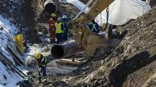 An Enbridge oil pipeline is seen being worked on in East Don Parkland in Toronto, March 6, 2014. (Mark Blinch/Reuters)