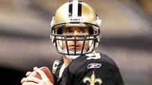 New Orleans Saints quarterback Drew Brees (9) warms up before taking on the St. Louis Rams during their NFL game in New Orleans, Louisiana December 12, 2010. (Sean Gardner/Reuters/Sean Gardner/Reuters)