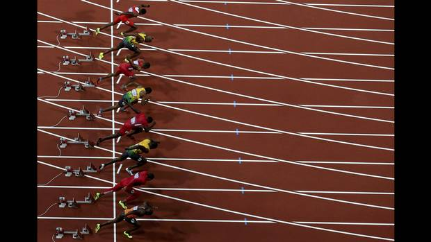 Competitors take off the starting blocks in the men's 100m final during the London 2012 Olympic Games at the Olympic Stadium August 5, 2012 (Reinhard Krause/Reuters)
