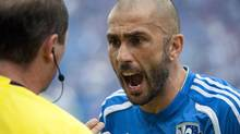 Montreal Impact's Marco Di Vaio, right, argues with an official during the second half of an MLS game against the Vancouver Whitecaps in Montreal, Saturday, September 21, 2013. (Graham Hughes/THE CANADIAN PRESS)