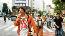 A demonstrator in Tokyo speaks in support of Fukushima Prefecture residents urging the Japanese government and Tokyo Electric Power Company to compensate residents of areas outside the evacuation zone who nevertheless decided to leave their homes due to radiation fears. (Kayo Yamawaki / The Globe and Ma/Kayo Yamawaki for The Globe and Mail)