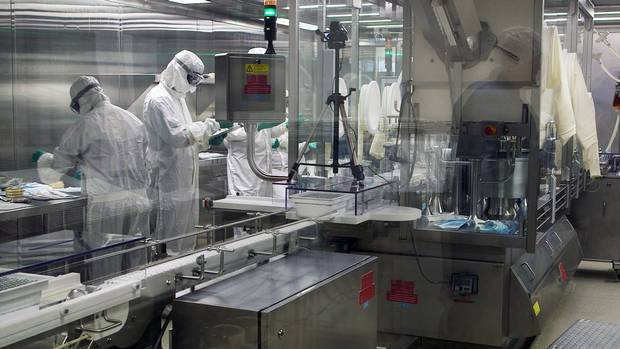 Workers at the Sainte Foy Vaccine Production Facility in Quebec City, Quebec