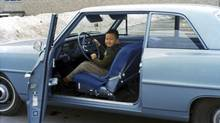 Charles Tan at age 6 in his family's new Chevy II.