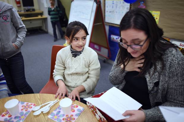 Eight-year-old Elham Nanaa, left, is learning to improve her English in an ESL class at Malvern Junior Public School in Toronto. Elham and her family fled the Syrian war when she was four, and she attended school in Turkey – meaning that, unlike many other Syrian schoolchildren, her education was not interrupted.