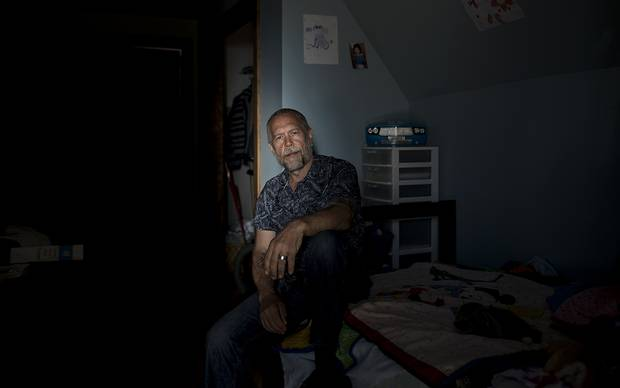 Wayne Jory, a longtime home builder who fell mysteriously ill after consuming medical marijuana that was later recalled due to banned pesticides, rests in one of his daughters' rooms in his home in Murray Harbour, PEI.