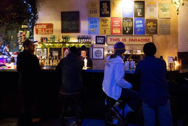 Behind the bar at The Cameron House is a sign that says it all for musicians and local music fans: This is paradise.