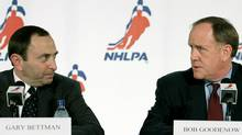 National Hockey League (NHL) commissioner Gary Bettman (L) and NHLPA Executive Director Bob Goodenow look at each other during a news conference announcing a new collective bargaining agreement and an end to the lockout between the players and the league in Toronto, July 21, 2005. (Reuters)