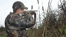 A hunter takes aim on his property near Fenelon Falls, Ont, on Octo 25, 2011. (FRED THORNHILL/Fred Thornhill for The Globe and Mail)