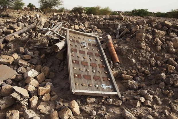 The rubble left from an ancient mausoleum destroyed by Islamist militants is seen in Timbuktu on July 25, 2013.