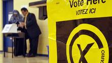 Voters cast their ballots in the Ontario provincial election at a Mississauga polling station on Oct. 10, 2007. (J.P. Moczulski/The Canadian Press)